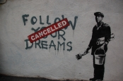 Banksy, F̶O̶L̶L̶O̶W̶ ̶Y̶O̶U̶R̶ ̶D̶R̶E̶A̶M̶S̶ CANCELLED Photo credit: Chris Devers, Flickr